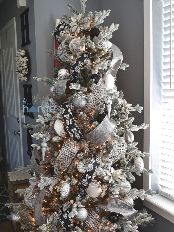 A silver, white, and black Christmas tree.